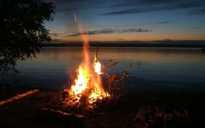 night fishing at campfire light